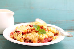 Crumble with strawberries Stock Images