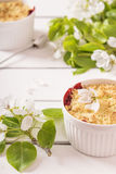 Crumble with strawberry and blackcurrant Stock Photography