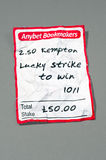 Crumbled betting slip with path Stock Photos