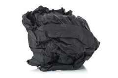 Crumbled black paper ball on white background Royalty Free Stock Photo