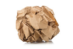 Crumbled brown recycled paper ball on white background Stock Photo