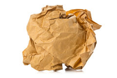 Crumbled brown recycled paper ball on white background Royalty Free Stock Image