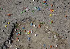 Crumbled candy on the road scattered casually . Stock Photo