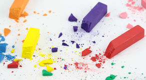 Crumbled color chalks Royalty Free Stock Images