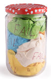 Crumbled color paper. In closed jar bottle Royalty Free Stock Photography