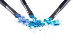 Crumbled compact blue eyeshadow different shades Royalty Free Stock Image