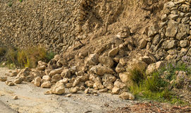 Crumbled contention wall. Destroyed masonry contention wall after a severe mudslide Stock Photography