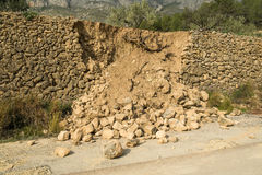 Crumbled contention wall. Destroyed masonry contention wall after a severe mudslide Stock Photo