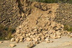 Crumbled contention wall. Destroyed masonry contention wall after a severe mudslide Royalty Free Stock Photo
