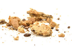 Crumbled cookie. Closeup of crumbled chocolate chip cookie on white floor Royalty Free Stock Photos