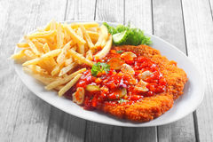 Crumbled Escalope with Sauce Paired with Fries Royalty Free Stock Photo