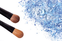 Crumbled eyeshadow with brush Stock Photos