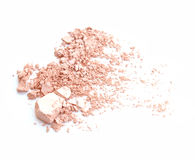 Crumbled natural powder make up on white background. stock photo