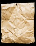 Crumbled Packing Paper. Crumbled brown packing paper pined on a board. File contains clipping path Stock Photography