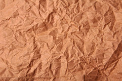 Crumbled Paper. Aged crumbled brown torn paper background Royalty Free Stock Photography