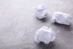 Crumbled paper on a grey concrete background, macro. Crumbled paper on a grey background, flat lay royalty free stock image