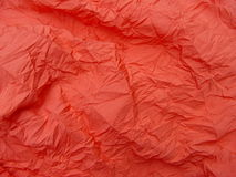 Crumbled silk. Salmon-orange silk cloth stock images