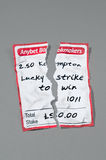 Crumbled and torn betting slip with path Stock Images