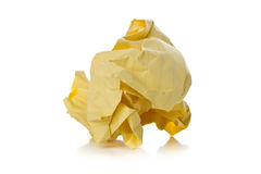 Crumbled yellow paper with linings ball on white background Stock Photos