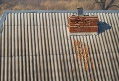 Crumbling brick chimney Stock Photo