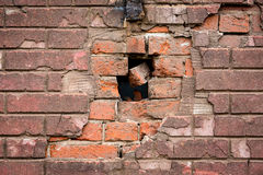 Crumbling Brick. Discolored brick that have been falling apart and crumbling on a old warehouse Stock Photos