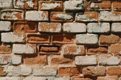 Crumbling brick wall. Closeup of an old, crumbling red brick wall Royalty Free Stock Photo