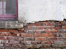 Crumbling brickwork of house Stock Photos