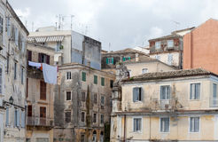 Crumbling buildings in Corfu. Dilapidated buildings in the backstreets of Corfu Town, Greece, where poverty leaves once grand houses to decay Stock Image