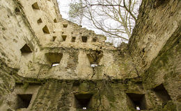 Crumbling castle. On the border of a village Royalty Free Stock Image