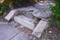 Crumbling cement steps. Crumbling cement sidewalk steps in historic Raleigh neighborhood Stock Photo