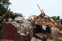 Crumbling Concrete And Falling Down Bricks With Piles Of Rubble Royalty Free Stock Photo