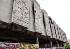 Crumbling concrete wall figures background building Royalty Free Stock Photos