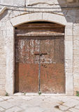 Crumbling door. Royalty Free Stock Image