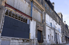 Crumbling Facade of Abandoned Warehouse Royalty Free Stock Images