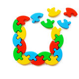Crumbling frame of colored puzzles Royalty Free Stock Photo