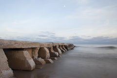 Crumbling icy cement pier along Lake Michigan Stock Image
