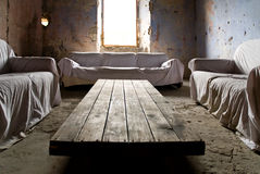 Crumbling living room. Crumbling relax room in an art exposition in tuscany royalty free stock photo