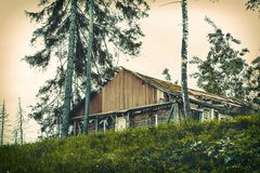 Crumbling old haunted house. Abandoned crumbling old wooden lonely house on the farm Stock Images