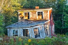 Crumbling in Owls Head, Maine. OWLS HEAD, ME - CIRCA 2009 - An aging home crumbles as time passes in Owl's Head, Maine. Owls Head is a sparse, rural area in Royalty Free Stock Photos