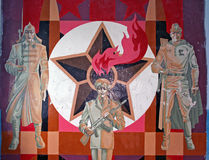 Crumbling painting of soviet soldiers  with soviet star in backg Royalty Free Stock Photos