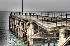 Crumbling pier Royalty Free Stock Photo
