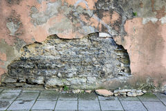 Crumbling plaster on the wall Royalty Free Stock Photos