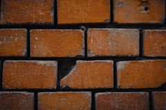 A crumbling red brick wall brick background. Grunge design abstract hand frame retro border house pattern vintage texture 3d construction art animal cement stock photos