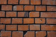 a crumbling red brick wall brick background stock images