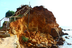 Crumbling rock on Mirissa beach Royalty Free Stock Photo
