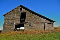 Crumbling See Through Barn. A crumbling old barn is has become so rickety the siding allow a see through view Stock Photography
