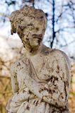 Crumbling statue of a beautiful woman Stock Photography