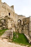 Crumbling Stone Steps and Exterior Castle Walls. Architectural Exterior View of Crumbling Stone Steps and Walls of Historical Castle Fortress on Overcast Day Stock Photos