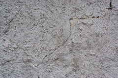 Crumbling wall. Detail of a crumbling rendered wall Stock Photo