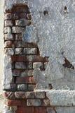 Crumbling wall of brick and plaster Royalty Free Stock Photos